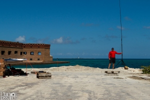 Posing next to the 1/4 wave vertical antenna on the North Coaling Docks at Fort Jefferson, Garden Key, Dry Tortugas